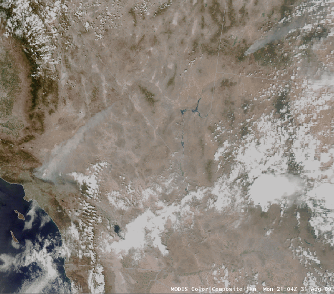 This MODIS true color image valid at the same time as the image above shows the full extent of the smoke plume associated with the Station Fire near Los Angeles, as well as another active fire in southwestern Utah.