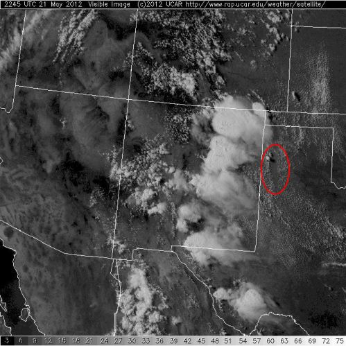 FIG 1.  GOES visible satellite image at 2245 UTC 21 May 2012.  Red label indicates location of patch where a lack of cumulus cloud development occurred.