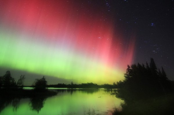 Photograph of the Aurora Borealis taken from Boulder Lake, MN around midnight local CDT 1-2 Oct 2013 (photo courtesy of Dan Miller, Science and Operations Officer NWS Duluth, MN)