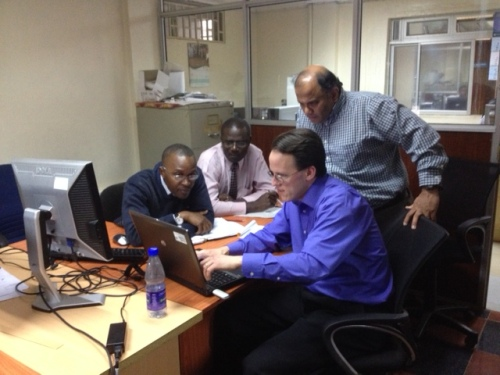 Jonathan Case of SPoRT and Dr. Ashutosh Limaye of SERVIR work with John Mungai and Vincent Sakwa of the Kenya Meteorological Service to install and test the SPoRT-MET scripts for conducting automated model verification.