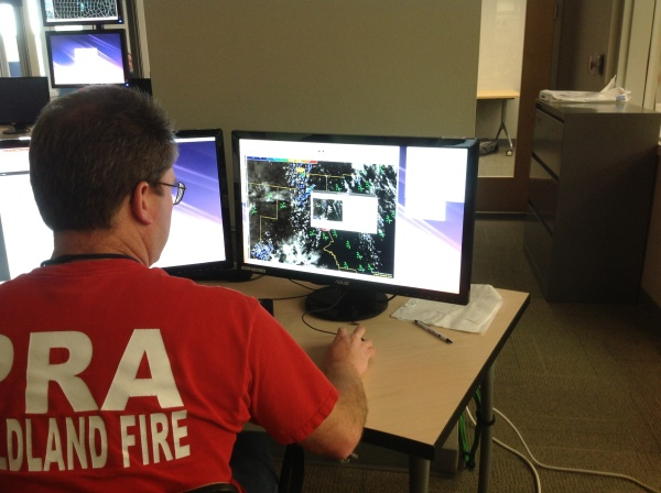 Image 1.  An NWS forecaster evaluates the Convective Initiation (CI) product at the HWT.