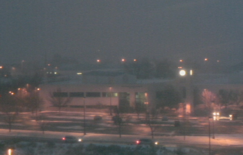 Figure 2b. Webcam at San Juan College shortly after sunset. Note the dramatic decrease in visibility and light snow accumulations on grassy surfaces in front of the college.
